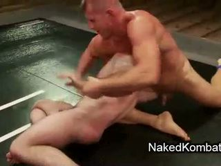 Two bare muscle gays wrestling