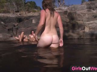 Young lesbian foursome outdoor bathing
