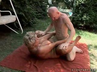Busty grandma enjoying hard sex outdoor