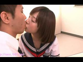 Sweet Japanese schoolgirl suckles on a thick cock