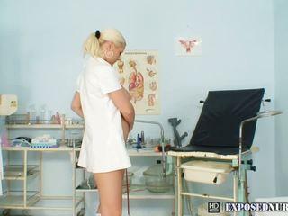 Dirty blonde nurse with large bazookas sticks dark dildo up her twat