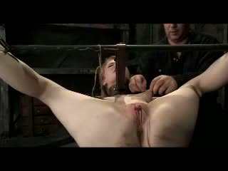 Redhead Girl Tied Legs And Arms Getting Her Pussy Stimulated With Vibrators Whipped By Master In The Dungeon