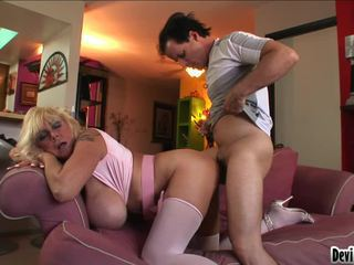Shelly Uses Her Large Pantoons To Rub Down Youthful Mans Hard Cock