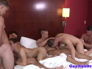 Beefy hunks enjoying jaw fest at hotel suite