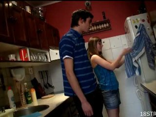Irresistible teen gets fucked in the kitchen