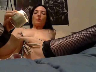 Pouring some hot wax all over her pussy Video