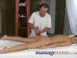 Massage Rooms Innocent young clits are aroused by mature masseuse fingers
