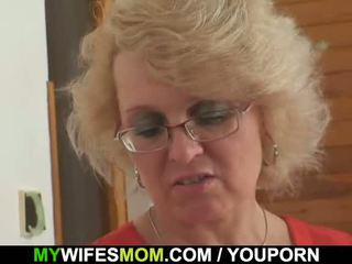 She finds her old mom riding her man s cock