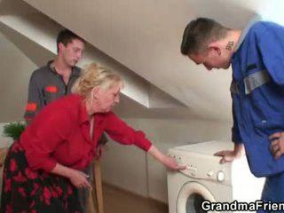 Two repairmen share busty grandma