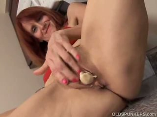 Redhead Mature in the kitchen