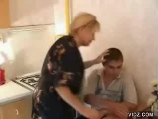 Ebony dude screws older blondie prostitute