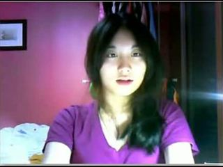 Asiática jovem grávida teasing em câmara