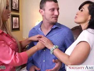 Hot wives Lisa Ann and Nikki Benz sharing a big dick