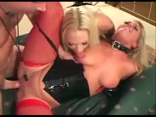 Two babes in latex gloves, corsets, stockings and boots fucking.