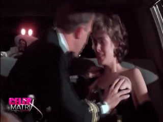 Sean Young MAking Out Involving The Bloke Inside The Car Round Her Nipple Pops Out Of Her Dress. Then Sean Little REmoving Her Fur Coat, Turning Around To Reveal Her Tits WHile Talking To Some People