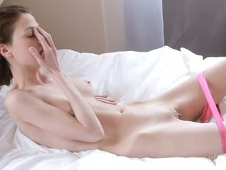 Nymph caresses wet snatch