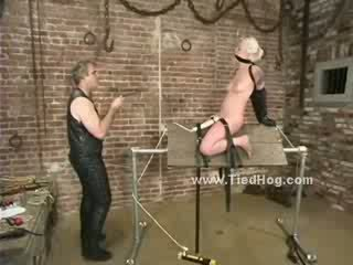 Blonde hanged upside down from the ceiling gets spanked and tortured in bizarre fetish sex video