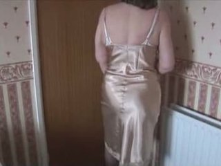 Hairy granny in slip and stockings with see