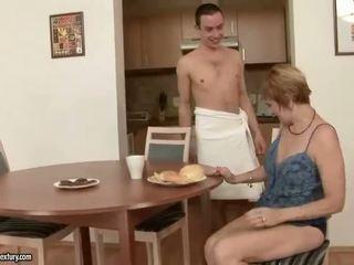 Hot grandma enjoys sex with a boy