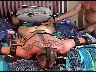 Muscled dude is bound and face down while I pound his nuts and then turn him over and pound more.