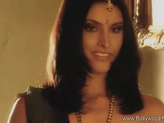 Bollywood beauty strips and teases