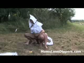 Adult perv in baby clothes ass fucked outdoors by strap-on