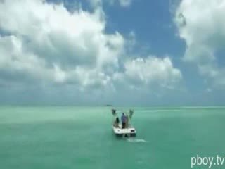Naughty and Nude playboy bunnies enjoying kite surfing