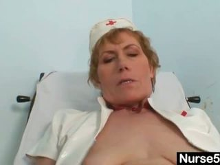 Naughty Head Nurses: Old mom self exam on gynochair with speculum