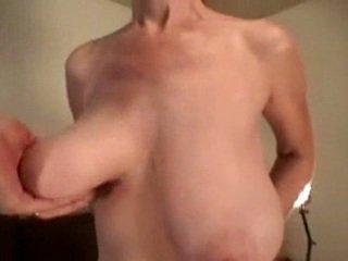 Unknown hand grabbing big saggy tits