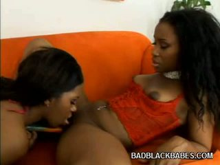 Concupiscent Ebonies Sharing A Dildo