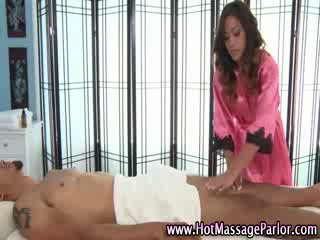 Masseuse babe sucking client cock