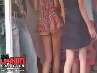 The hot pants of this gal are so small that you can hardly see them under her long top