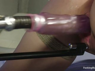 Short-haired young girl boung and fucked by hot machines.