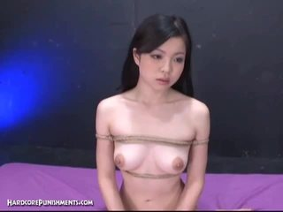 Japanese babe punished by two horny guys