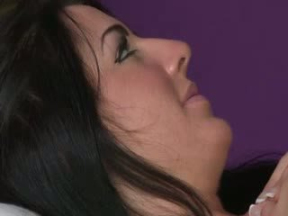 dark haired therapist rubbing her client down with her big Juggs