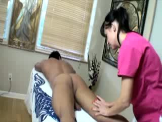 Masseuse massaging horny clients dick