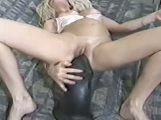 Blond Milf Sits On A Huge Dildo
