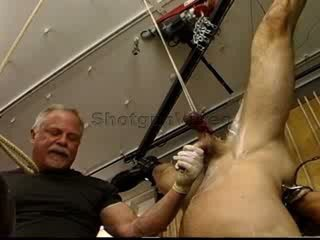 Jim Roberts suspended upside down stuffed with a big dildo and balls BenGayed and CBT