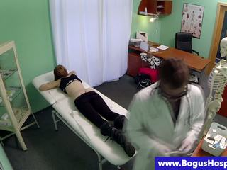 Pretend doctor fingering her patients sweet pussy