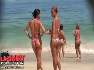 The horny girls from this bikini voyeur video are wearing micro thongs on juicy asses