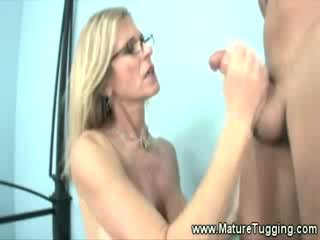 Older milf satisfies chick boys Cocks by hand