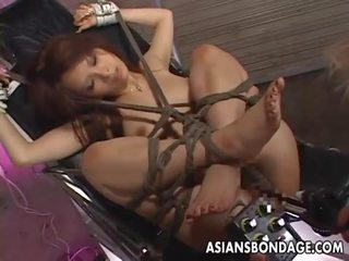 Tied up puta gets banged by various things
