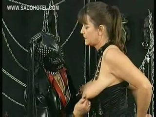 Masked mistress wearing leather mask plays with tits of slav