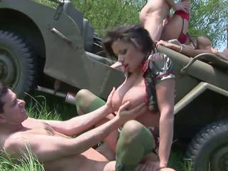 Naughty Army Sluts get Banged by Two Soldiers in a Jeep