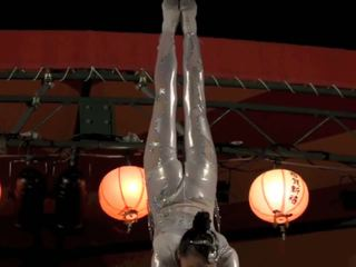 Gorgeous Chinese Girl Performing Death Defying Stunt...