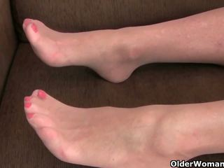 Pantyhosed grandma presses her pleasure buttons