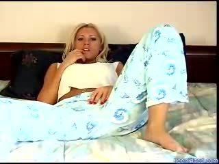 Dirty blonde teen in pyjamas plays with her vag in bedroom