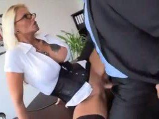 Blonde-haired girl having sex in the office