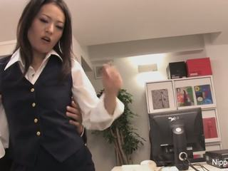 Secretary plays with his cock with her mouth and feet