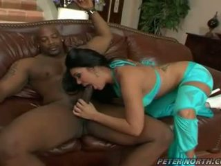 Pornstar Olivia Olovely swallowing a thick hard black meatpole